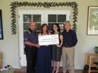 Midas Hawaii Making Donation - Bob and Dianne Pereira, Gerri Chong & Bruce Yanagihara from Ronald McDonald House Charities